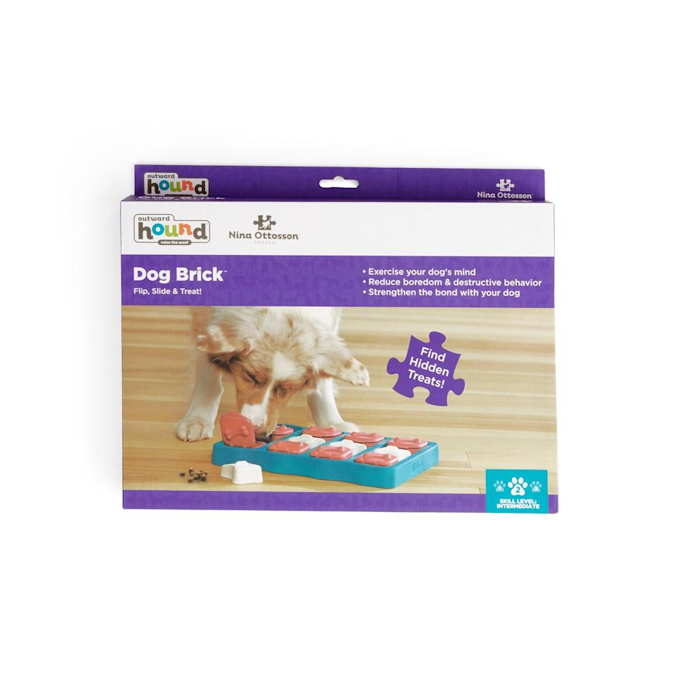 """<p><strong>outward hound</strong></p><p>petco.com</p><p><strong>$24.99</strong></p><p><a href=""""https://go.redirectingat.com?id=74968X1596630&url=https%3A%2F%2Fwww.petco.com%2Fshop%2Fen%2Fpetcostore%2Fproduct%2Foutward-hound-brick-blue-puzzle-dog-toy-large-3128211&sref=https%3A%2F%2Fwww.womansday.com%2Flife%2Fpet-care%2Fg36125697%2Ftop-dog-products%2F"""" rel=""""nofollow noopener"""" target=""""_blank"""" data-ylk=""""slk:Shop Now"""" class=""""link rapid-noclick-resp"""">Shop Now</a></p><p>Keeping your dogs entertained while they're home alone can seem like a challenge, especially if your pup has separation anxiety. Brain-stimulating games like this puzzle toy has compartments for you to hide treats in. </p>"""
