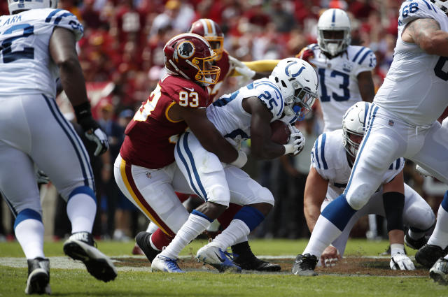 FILE - In this Sept. 16, 2018, file photo, Washington Redskins defensive end Jonathan Allen, left, tackles Indianapolis Colts running back Marlon Mack in the first half of an NFL football game, in Landover, Md. After having one the worst run defense in the NFL last season, the Washington Redskins have improved in that area enough that they go into a matchup against the Dallas Cowboys. (AP Photo/Alex Brandon, File)
