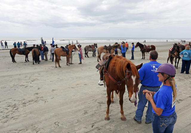 """FILE - In this March 25, 2017, file photo, riders and owners prepare their horses before the start of the inaugural Kiawah Cup Island Beach Race at Beachwalker Park on Kiawah Island in South Carolina. Stephen Leatherman, a coastal scientist and professor at Florida International University, has been drafting a list of the best beaches in the U.S. under alias """"Dr. Beach"""" since 1991. This year he has named Beachwalker Park the 10th-best in the country. (Michael Pronzato/The Post And Courier via AP, File)"""