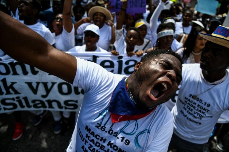 Demonstrators shout slogans during a protest against sexual violence in Port-au-Prince, Haiti on May 26, 2019