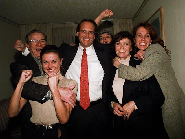 <p>Attorney John Q. Kelly, center, is embraced by members of the Brown family following a verdict in the O.J. Simpson wrongful death civil suit, Tuesday night, Feb. 4, 1997. From left, Lou Brown, Dominique Brown, Kelly, Juditha Brown, Tanya Brown and Denise Brown in background. Simpson was found liable for the deaths of Nicole Brown Simpson and Ronald Goldman. (Photo: Nick Ut/AP) </p>