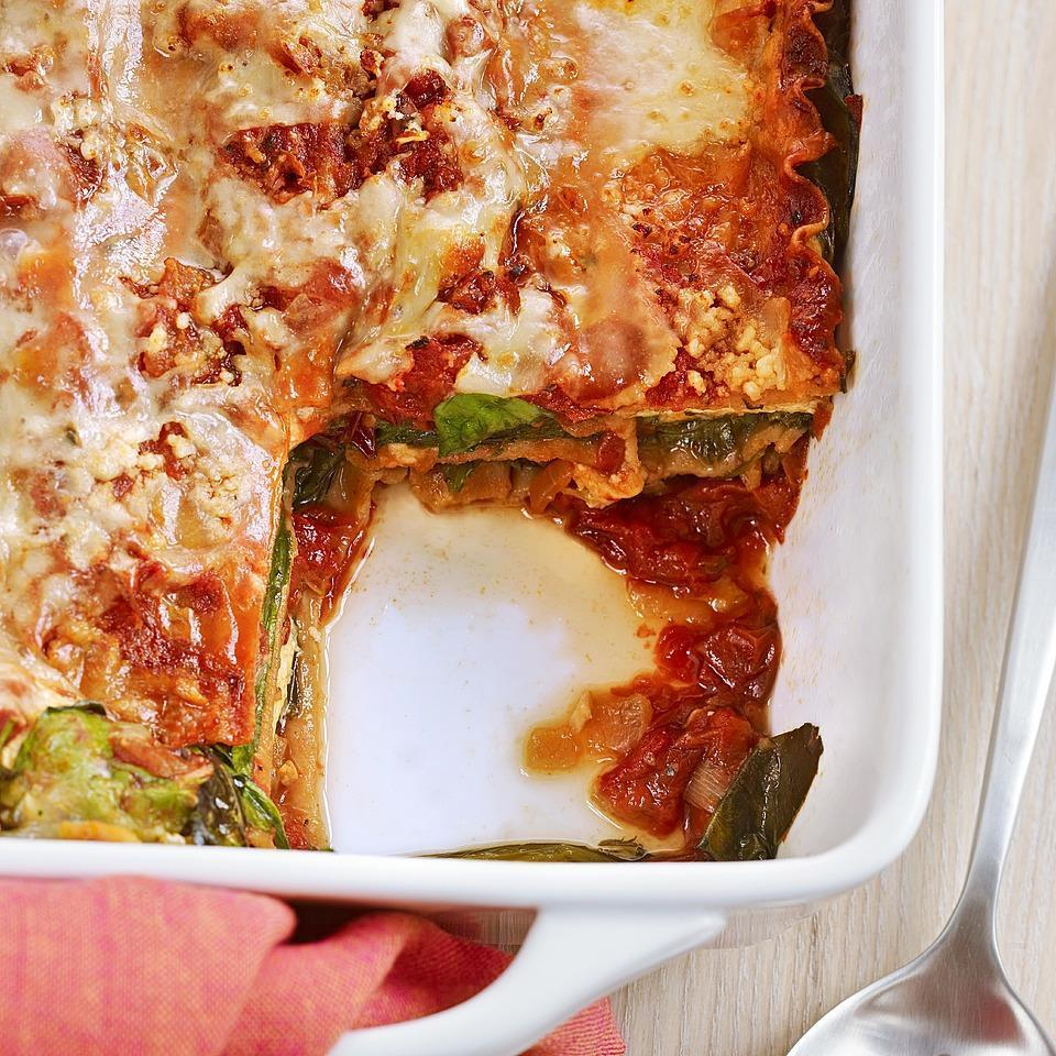 """<p>Slow-roasting the tomatoes gives the tomato sauce for this lasagna recipe an intense depth of flavor--which is then enhanced by the umami in onions, Parmesan and spinach. The lasagna noodles are layered into the lasagna uncooked; the moisture from the fresh spinach cooks them perfectly as the lasagna bakes in the oven. <a href=""""https://www.eatingwell.com/recipe/250487/lasagna-with-slow-roasted-tomato-sauce/"""" rel=""""nofollow noopener"""" target=""""_blank"""" data-ylk=""""slk:View Recipe"""" class=""""link rapid-noclick-resp"""">View Recipe</a></p>"""