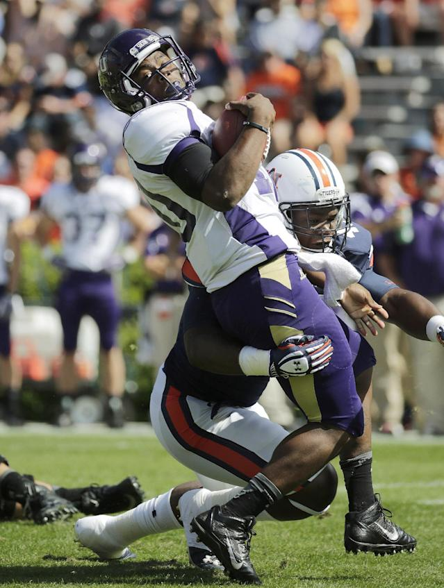 Western Carolina quarterback Troy Mitchell (10) is stopped for a loss by Auburn linebacker Anthony Swain, right, during the first half of an NCAA college football game in Auburn, Ala., Saturday, Oct. 12, 2013. (AP Photo/Dave Martin)