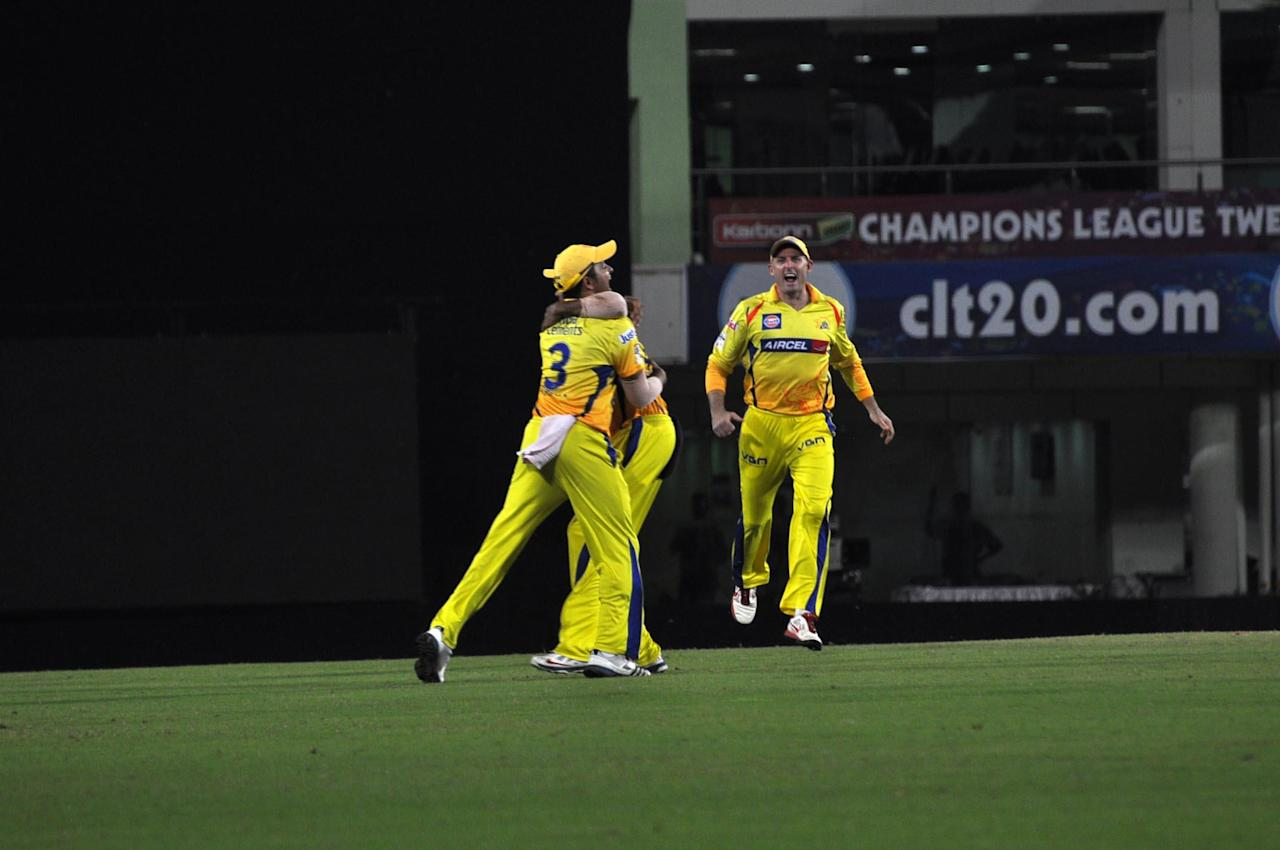Chennai Super Kings players celebrate a wicket against Brisbane Heat during the CLT20 match at JSCA Stadium in Ranchi on Sept. 28, 2013. (Photo: IANS)