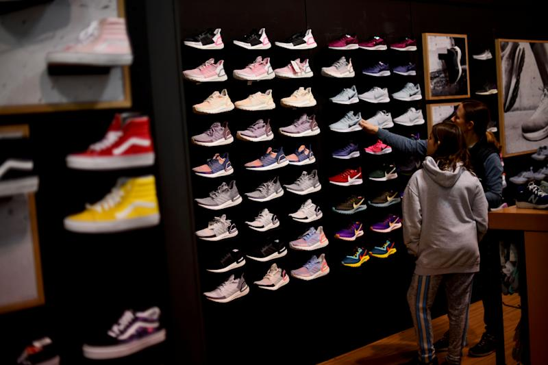 Audrey Topkin, 11, selects sneakers with her mother, Robyn, at a Dick's Sporting Goods store as pre-Thanksgiving and Christmas holiday shopping accelerates at the King of Prussia Mall in King of Prussia, Pennsylvania, U.S. November 22, 2019. REUTERS/Mark Makela