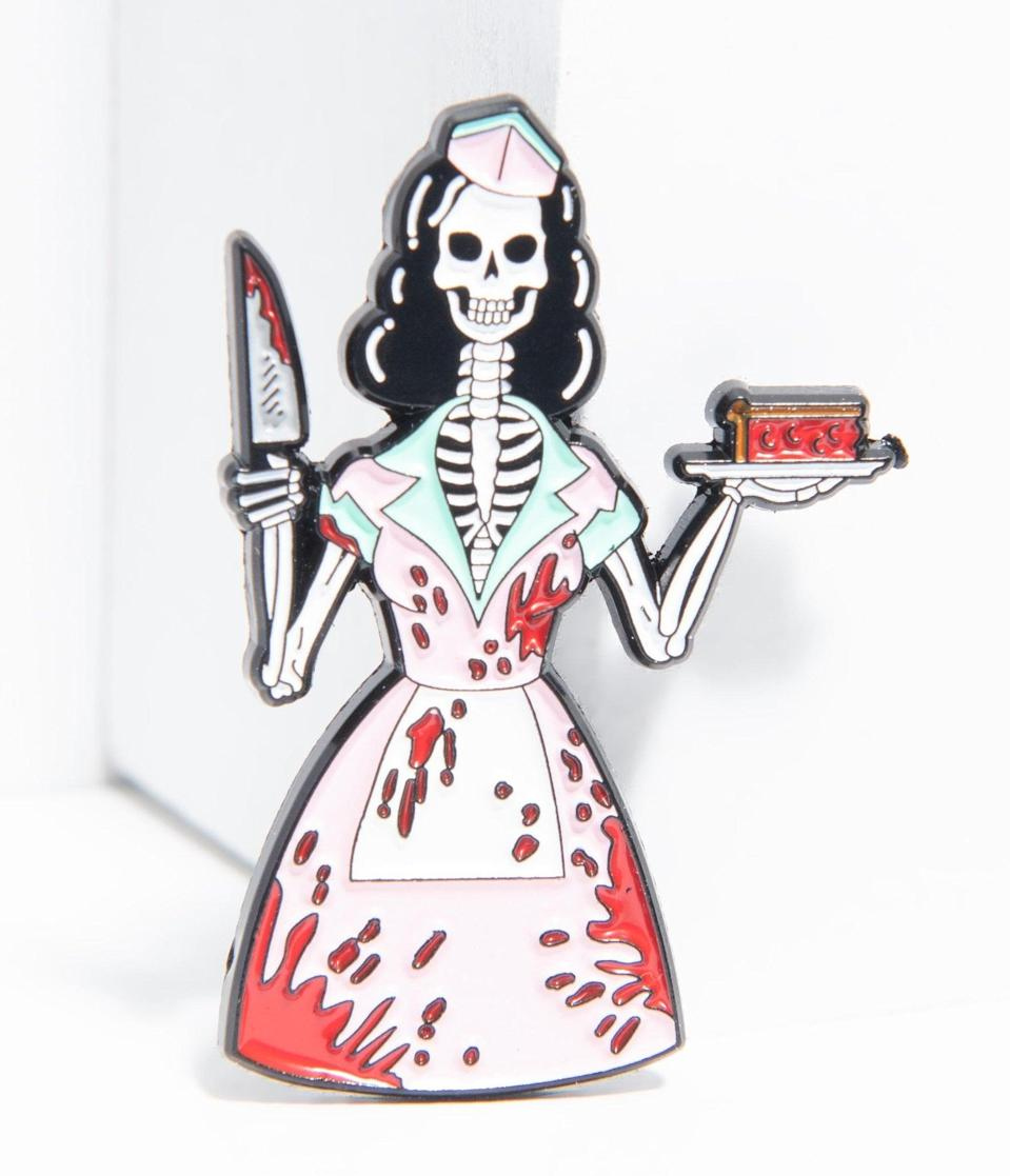 <p>This spine-chilling <span>1950s Bloody Skeleton Waitress Enamel Pin</span> ($16) will make any outfit spooky. </p>