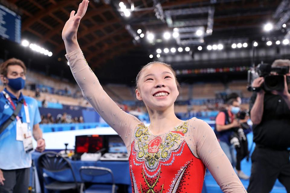 <p>Gold medalist Chenchen Guan of Team China waves to the crowd of athlete spectators after her big win at Ariake Gymnastics Centre on August 3.</p>