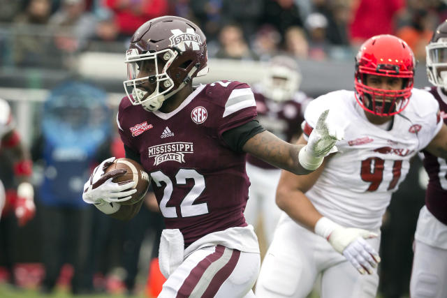 Mississippi State running back Aeris Williams (22) crosses the goal line for a touchdown during the first half of the TaxSlayer Bowl NCAA college football game against Louisville, Saturday, Dec. 30, 2017, in Jacksonville, Fla. (AP Photo/Stephen B. Morton)