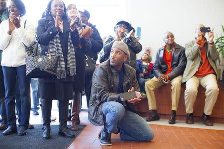 """Matt Talford (kneeling), a resident of Rock Hill, watches court proceedings with others as a group of black civil rights protesters nicknamed the """"Friendship Nine"""" appear at a courthouse to have their trespassing convictions vacated, in Rock Hill, South Carolina January 28, 2015.      REUTERS/Jason Miczek"""