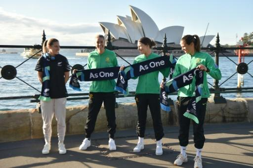 New Zealand's Rebekah Stott (L) posed with Australia players Alanna Kennedy, Steph Catley and Lydia Williams after the announcement