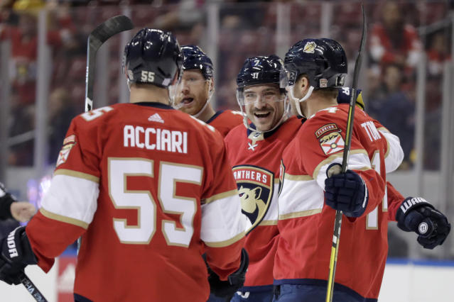 Florida Panthers center Colton Sceviour (7) celebrates with center Noel Acciari (55) and Dominic Toninato, right, after scoring a goal during the first period of an NHL hockey game against the Philadelphia Flyers, Tuesday, Nov. 19, 2019, in Sunrise, Fla. (AP Photo/Lynne Sladky)