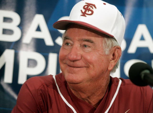 FILE - In this June 1, 2012, file photo, Florida State coach Mike Martin smiles during a game in Tallahassee, Fla. Mike Martin has seen college baseball grow nationally in his 39 seasons as Florida States coach. His success leading the Seminoles though has remained a constant. Martin, who has 1,974 wins, needs three more to pass Augie Garrido for the most victories in NCAA baseball history. He could get the milestone this weekend when Florida State hosts Miami in a three-game series, April 27-29, 2018, in Tallahassee. (AP Photo/Phil Sears, File)