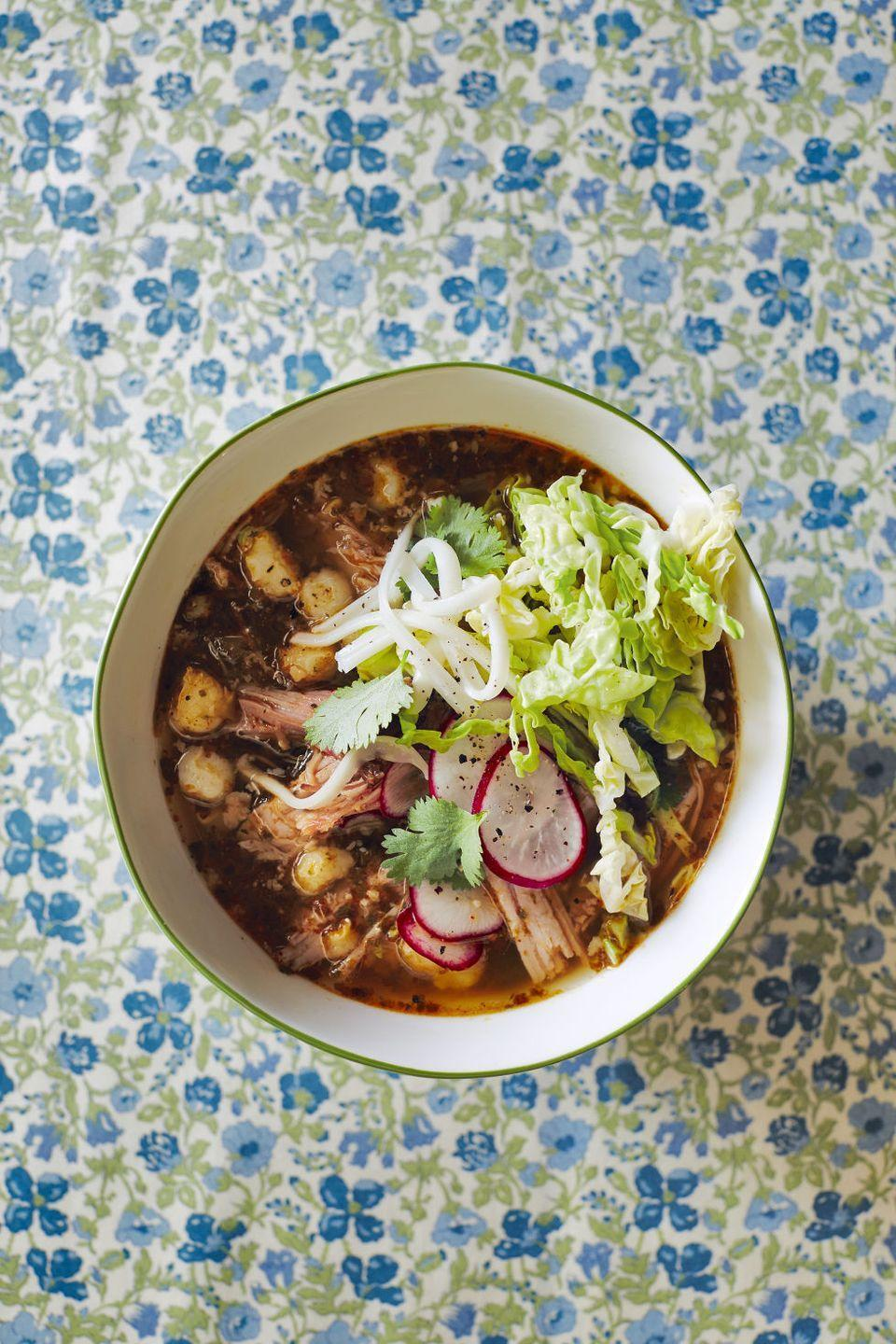 """<p>Warm up a cool night with this flavorful and filling pork stew.</p><p><strong><a href=""""https://www.countryliving.com/food-drinks/recipes/a5795/spicy-pork-posole-recipe-clx1014/"""" rel=""""nofollow noopener"""" target=""""_blank"""" data-ylk=""""slk:Get the recipe"""" class=""""link rapid-noclick-resp"""">Get the recipe</a>.</strong></p>"""