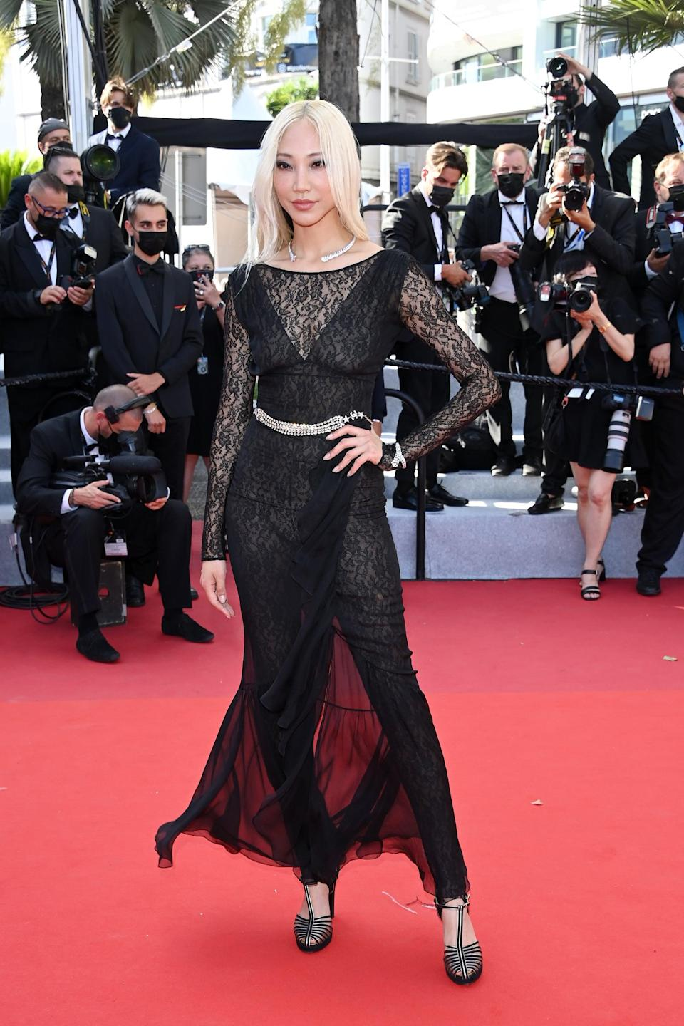 <p>Wearing a black lace outfit.</p>