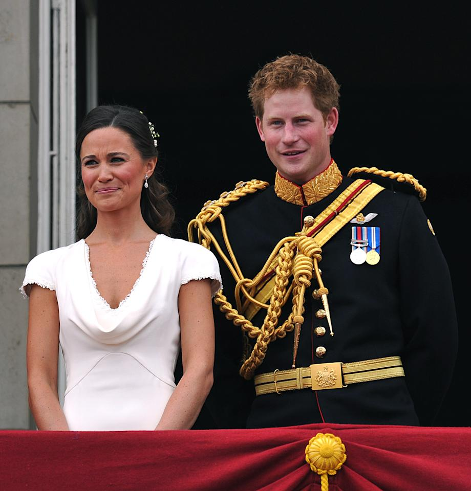 Britain's Prince Harry (R) and Pippa Middleton stand on the balcony of Buckingham Palace, following following the wedding of Prince William and Kate Middleton at Westminster Abbey in London April 29, 2011.    REUTERS/John Stillwell/Pool