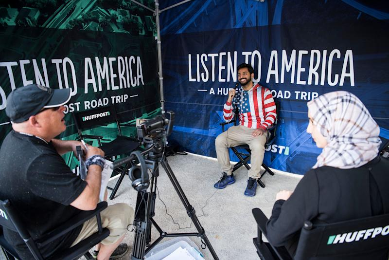 Hassan Sheikh (center) is interviewed during HuffPost's visit to Detroit.