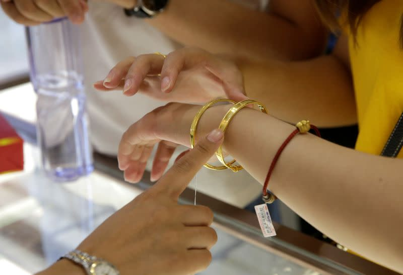 Gold steady as dollar gains; U.S.-China tensions resurface