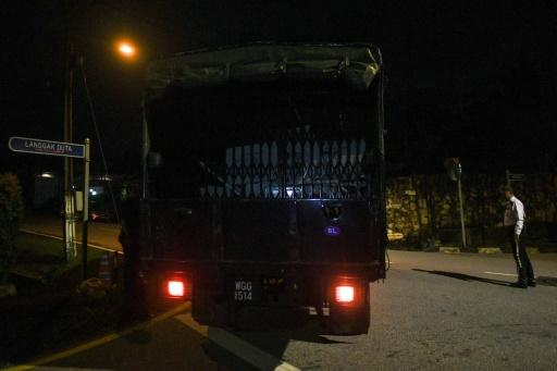 A police truck was among the vehicles that converged for the search on former leader Najib Razak's home