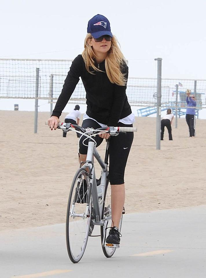"""A newly pregnant (or soon to be!) Kate Hudson did a little beachside biking with her parents, Goldie Hawn and Kurt Russell, and now fiance, Muse frontman Matt Bellamy, back in September. The """"Something Borrowed"""" star is due with her second child soon. Giovanni/<a href=""""http://www.splashnewsonline.com"""" target=""""new"""">Splash News</a> - September 8, 2010"""
