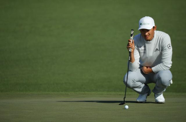 Li Haotong of China looks over his putt on the second hole during second round play of the 2018 Masters golf tournament at the Augusta National Golf Club in Augusta, Georgia, U.S., April 6, 2018. REUTERS/Brian Snyder
