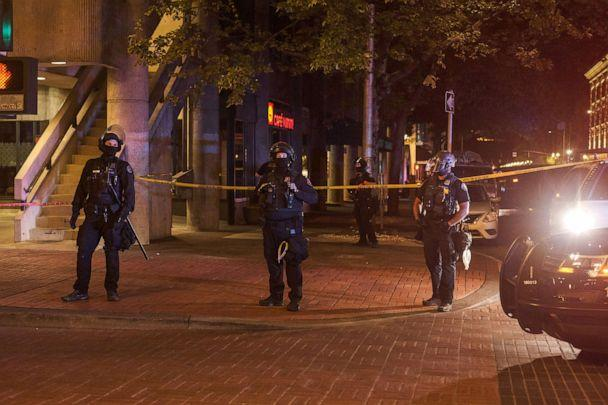 PHOTO: Police officers guard an area where Aaron Danielson was shot and killed at a protest in Portland, Ore., Aug. 29, 2020. (Mason Trinca/The New York Times via Redux, FILE)