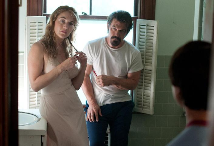 """This image released by Paramount Pictures shows Kate Winslet, from left, Josh Brolin and Gattlin Griffith in a scene from """"Labor Day."""" (AP Photo/Paramount Pictures, Dale Robinette)"""