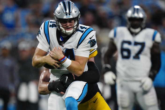 Carolina Panthers quarterback Sam Darnold is tackled by Pittsburgh Steelers linebacker Robert Spillane during the first half of a preseason NFL football game Friday, Aug. 27, 2021, in Charlotte, N.C. (AP Photo/Jacob Kupferman)