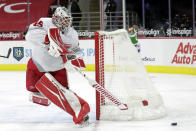 Detroit Red Wings' goaltender Jonathan Bernier (45) plays the puck during the second period of an NHL hockey game against the Carolina Hurricanes in Raleigh, N.C., Thursday, March 4, 2021. (AP Photo/Chris Seward)