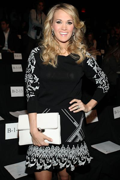 Singer Carrie Underwood attends Rebecca Minkoff Fall 2014 Collection during Mercedes-Benz Fashion Week on Friday, Feb. 7, 2014 at Lincoln Center in New York. (Photo by Omar Vega/Invision/AP)