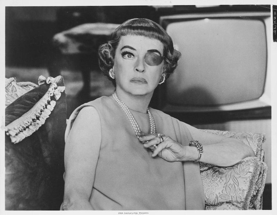 <p>Bette Davis exuded glamour in <em>The Anniversary</em>. The actress wore lots of jewels during the film, but none complimented her prop eye patch as well as her diamond palm earrings. </p>