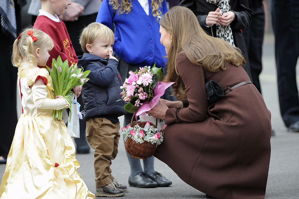 omg! users love their Kate Middleton and voted via Twitter on Tuesday to include this pic in the day's Top Shots update. Catherine, Duchess of Cambridge has a few months left before she becomes a mom, but she certainly looked the part when she greeted some children during an official visit to a fire station in England on Tuesday. And yes, that little boy is doing what you think he's doing, but hey, it comes with the territory! (3/5/2013)