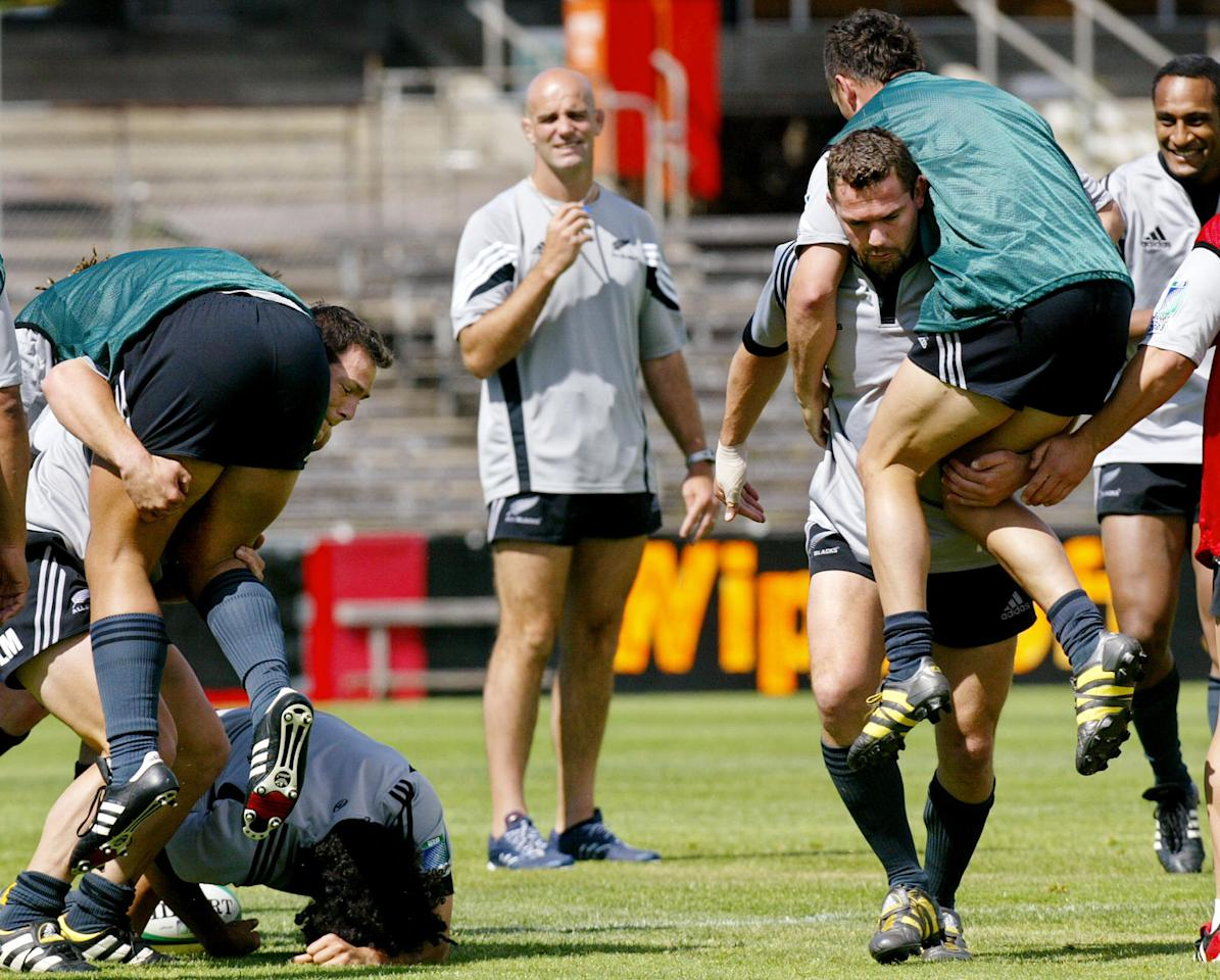 New Zealand All Black coach John Mitchell (C) watches captain Reuben Thorne (2/R) pick up winger Caleb Ralph (R) and centre Leon MacDonald (2/L) picks up centre Ma'a Nonu (2/L) during a practice session in Melbourne 18 November 2003. The All Blacks will play France in the playoff for 3rd & 4th place in Sydney 20 November with Australia and England to clash in the final 22 November. AFP PHOTO WILLIAM WESTNew Zealand All Black coach John Mitchell (C) watches captain Reuben Thorne (2/R) pick up winger Caleb Ralph (R) and centre Leon MacDonald (2/L) picks up centre Ma'a Nonu (2/L) during a practice session in Melbourne 18 November 2003. The All Blacks will play France in the playoff for 3rd & 4th place in Sydney 20 November with Australia and England to clash in the final 22 November. AFP PHOTO WILLIAM WEST (AFP Photo/WILLIAM WEST)