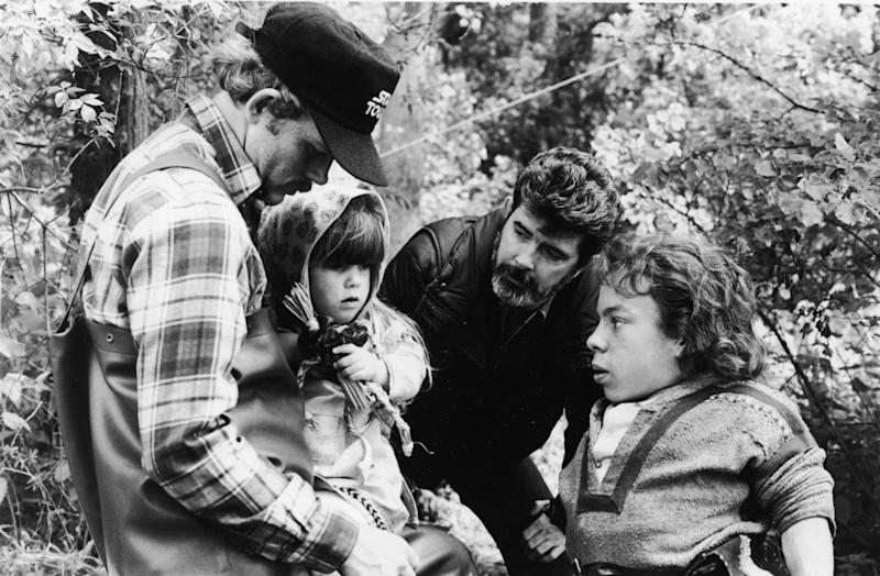 American actor and director Ron Howard, actor Dawn Downing, American director and producer George Lucas, and British actor Warwick Davis discuss a scene on the set of the fantasy feature film, 'Willow,' 1988. (Photo by Lucasfilm/MGM/Courtesy of Getty Images)