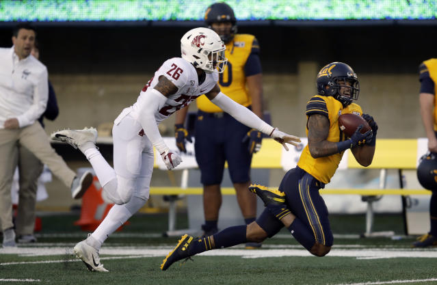 California's Kekoa Crawford, right, makes a pass reception ahead of Washington State's Bryce Beekman during the first half of an NCAA college football game Saturday, Nov. 9, 2019, in Berkeley, Calif. (AP Photo/Ben Margot)