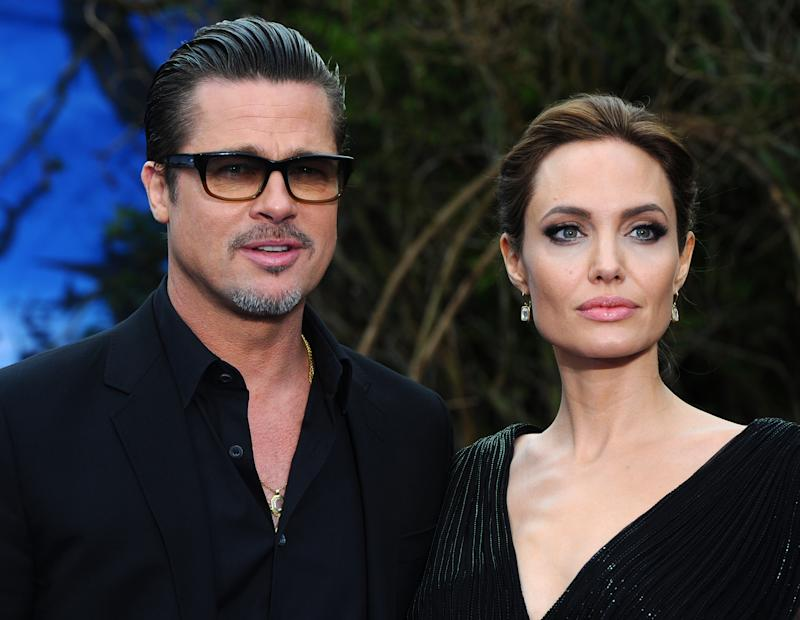 "Brad Pitt and Angelina Jolie attend a private reception as costumes and props from Disney's ""Maleficent"" are exhibited in support of Great Ormond Street Hospital at Kensington Palace on May 8, 2014 in London, England."