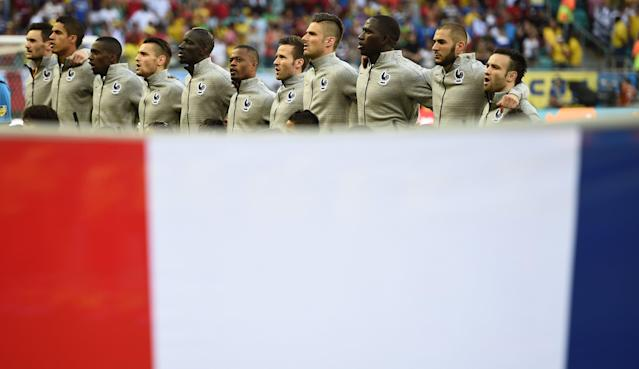 France national soccer team players sing the national anthem beofre the start of the 2014 World Cup Group E soccer match against Switzerland at the Fonte Nova arena in Salvador June 20, 2014. REUTERS/Dylan Martinez (BRAZIL - Tags: SOCCER SPORT WORLD CUP)