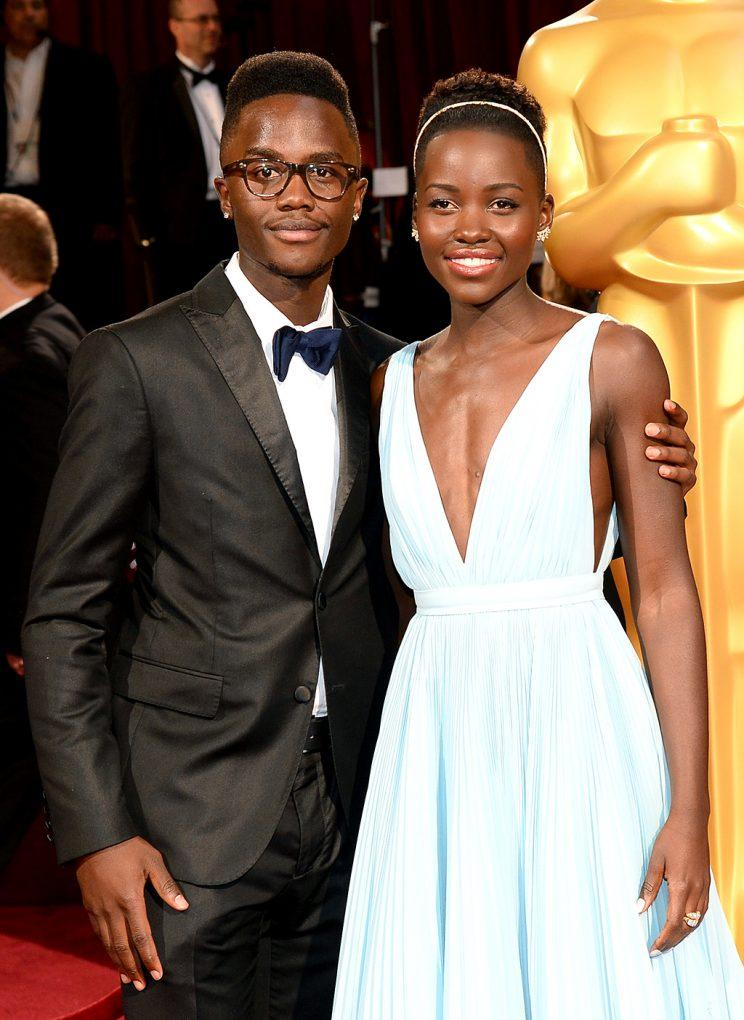 Lupita Nyong'o brought her brother Peter Nyong'o Jr. as her date to the 2014 Oscars. (Photo: Ethan Miller/WireImage)