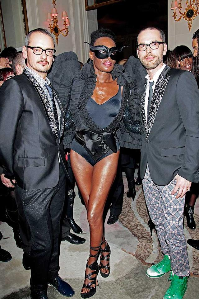 "The original shock diva Grace Jones -- flanked by the Victor & Rolf designers at their Flower Bomb 5th Anniversary party -- was utterly fabulous in a Venetian mask and winged bodysuit. Gaga and Rihanna, watch and learn! Julien Hekimian/<a href=""http://www.wireimage.com"" target=""new"">WireImage.com</a> - March 4, 2010"