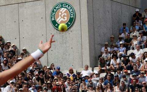 A player gets ready to serve - Credit: AP