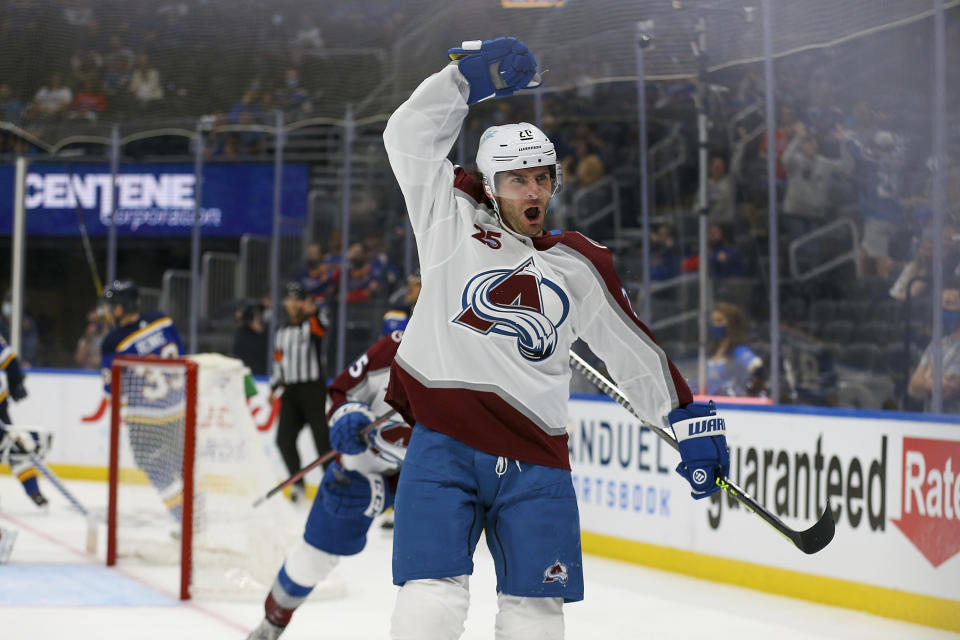 Colorado Avalanche's Brandon Saad (20) celebrates his goal against the St. Louis Blues during the third period in Game 3 of an NHL hockey Stanley Cup first-round playoff series Friday, May 21, 2021, in St. Louis. (AP Photo/Scott Kane)