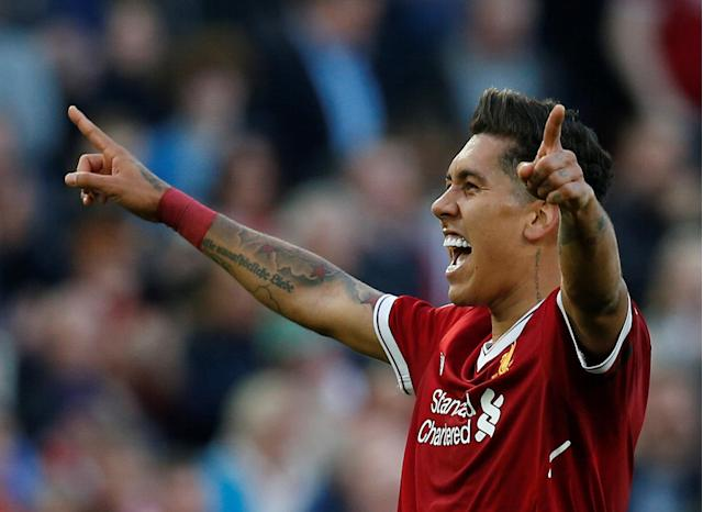 "Soccer Football - Premier League - Liverpool vs AFC Bournemouth - Anfield, Liverpool, Britain - April 14, 2018 Liverpool's Roberto Firmino celebrates scoring their third goal with team mates REUTERS/Andrew Yates EDITORIAL USE ONLY. No use with unauthorized audio, video, data, fixture lists, club/league logos or ""live"" services. Online in-match use limited to 75 images, no video emulation. No use in betting, games or single club/league/player publications. Please contact your account representative for further details."
