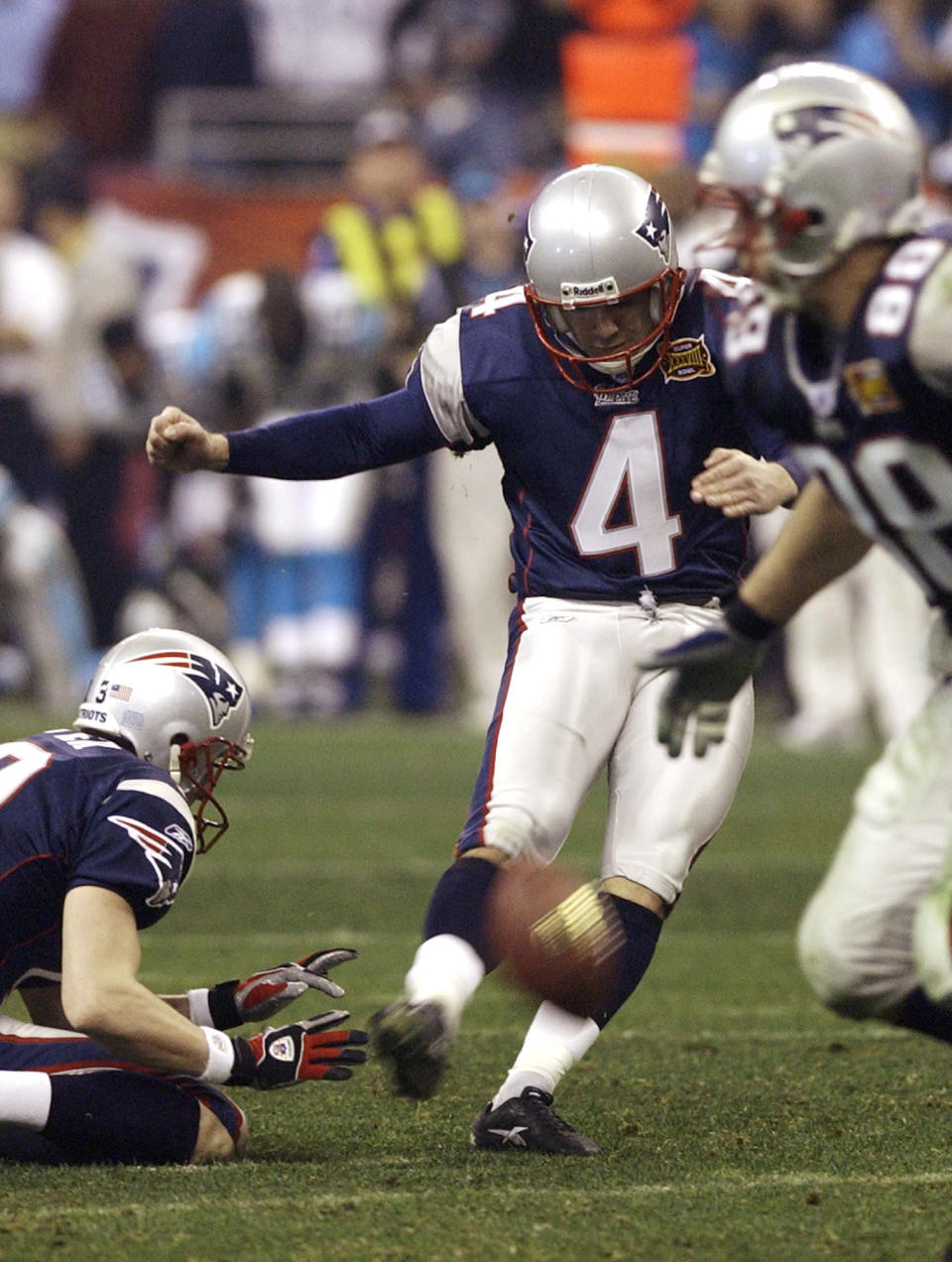 FILE - In this Feb. 1, 2004, file photo, New England Patriots kicker Adam Vinatieri (4) kicks the winning field goal in the final seconds to defeat the Carolina Panthers in Super Bowl XXXVIII at Reliant Stadium in Houston. For the second time in three years, Vinatieri made the winning field goal to lift New England to the NFL title. (AP Photo/Elise Amendola, File)