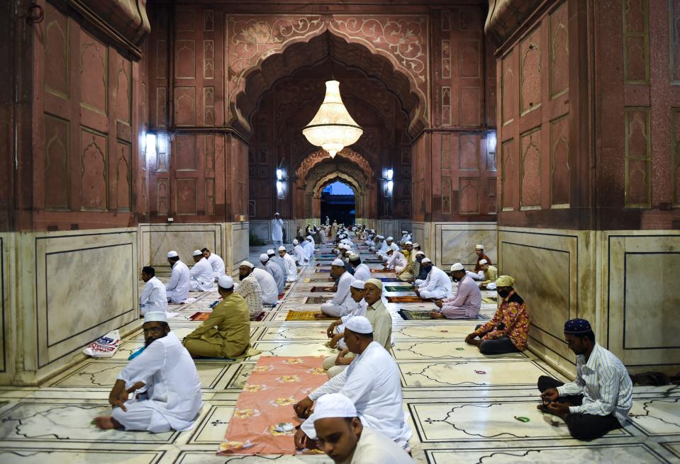 Muslim devotees wait to offer a special morning prayer to kick off the Eid al-Adha, the feast of sacrifice, at Jama Masjid mosque in New Delhi on August 1, 2020. (Photo by Money SHARMA / AFP) (Photo by MONEY SHARMA/AFP via Getty Images)