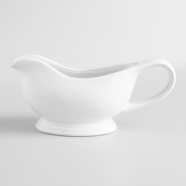 "This perfectly proportioned <a href=""https://www.worldmarket.com/product/white-gravy-boat.do?sortby=ourPicks&from=Search"" target=""_blank"">white gravy boat</a> is a staple for entertaining."