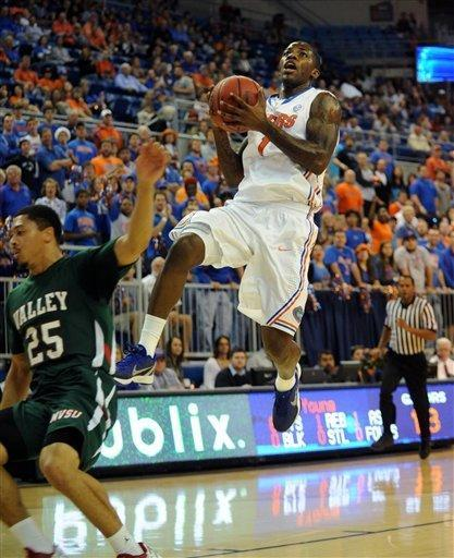 Florida's Kenny Boynton (1) goes up for two points with Mississippi Valley State's Kevin Burwell (25) missing the block during the first half of an NCAA college basketball game in Gainesville, Fla., Monday, Dec. 19, 2011. (AP Photo/Phil Sandlin)