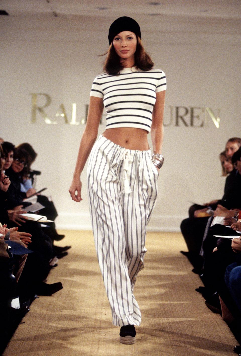 <p>Christy wears matching stripes on the runway at the Ralph Lauren Spring Show, 1993</p>