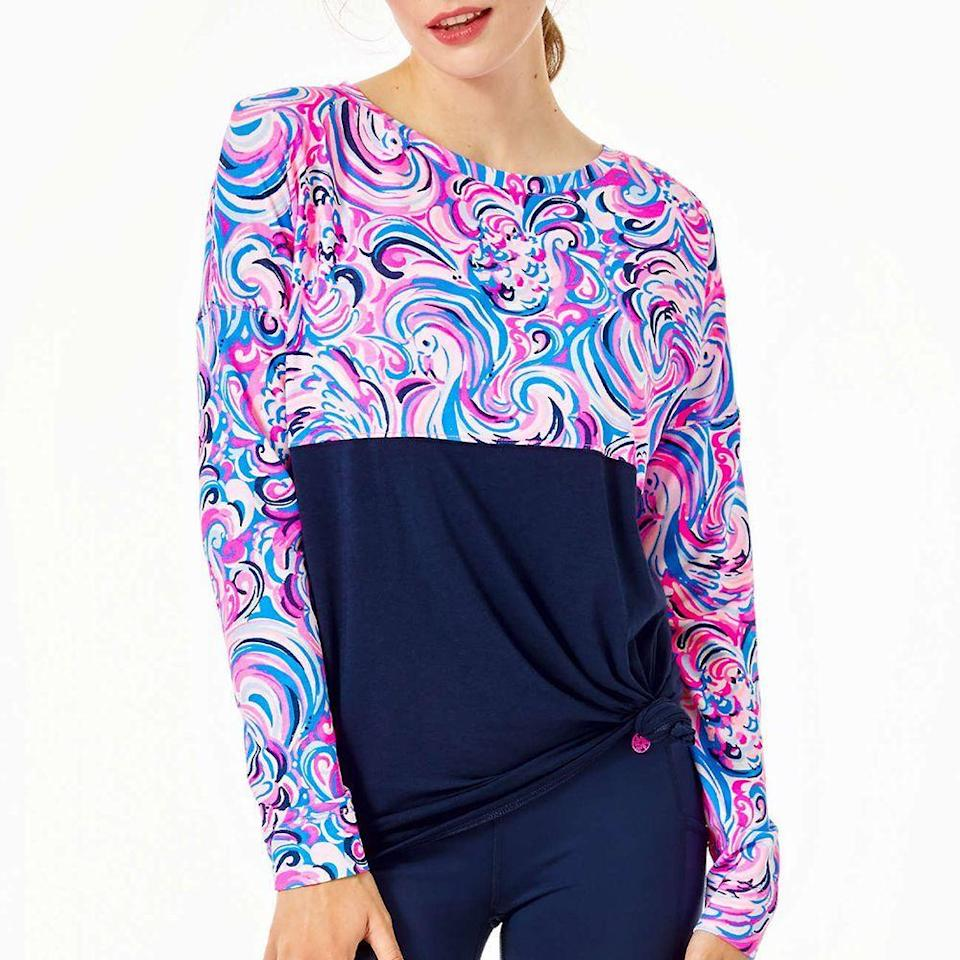 """<p><strong>Lilly Pulitzer</strong></p><p>lillypulitzer.com</p><p><strong>$68.00</strong></p><p><a href=""""https://go.redirectingat.com?id=74968X1596630&url=https%3A%2F%2Fwww.lillypulitzer.com%2Ffinn-top%2F000130.html%3Fdwvar_000130_color%3D63527L&sref=https%3A%2F%2Fwww.prevention.com%2Flife%2Fg34387434%2Fbreast-cancer-shirts-clothing%2F"""" rel=""""nofollow noopener"""" target=""""_blank"""" data-ylk=""""slk:SHOP NOW"""" class=""""link rapid-noclick-resp"""">SHOP NOW</a></p><p>These fun color-blocking tops from Lilly Pulitzer are all super comfortable to wear thanks to its relaxed fit and soft cotton blend. The long-sleeve top comes in six different styles, but we especially like this pick called """"Raz Berry Flamingoals."""" The print design is part of the brand's <a href=""""https://go.redirectingat.com?id=74968X1596630&url=https%3A%2F%2Fwww.lillypulitzer.com%2Fprint%2Fstory%2Fpaws-for-a-cause.html&sref=https%3A%2F%2Fwww.prevention.com%2Flife%2Fg34387434%2Fbreast-cancer-shirts-clothing%2F"""" rel=""""nofollow noopener"""" target=""""_blank"""" data-ylk=""""slk:Paws for a Cause"""" class=""""link rapid-noclick-resp"""">Paws for a Cause</a> collection that supports BCRF. </p>"""