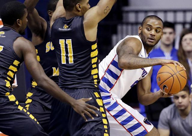 DePaul center Tommy Hamilton IV, right, looks to pass against Southern Mississippi forward Daveon Boardingham (11), guard Matt Bingaya and guard Chip Armelin, left, during the first half of an NCAA college basketball game in Rosemont, Ill., Wednesday, Nov. 13, 2013. (AP Photo/Nam Y. Huh)