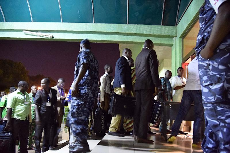 Members of the electoral committee, observers and representatives of the candidates arrive at the headquarters of the Independent National Electoral Commission (INEC) in Lome late on April 26, 2015 (AFP Photo/Issouf Sanogo)