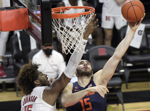 Illinois forward Giorgi Bezhanishvili (15) shoots as Rutgers center Myles Johnson, left, defends during the first half of an NCAA college basketball game Sunday, Dec. 20, 2020, in Piscataway, N.J. (AP Photo/Bill Kostroun)